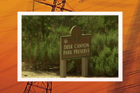 "Wooden sign with ""Deer Canyon Park Preserve"" text"