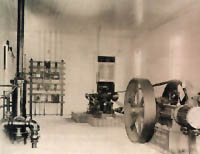 An old photo of a room with electricity equipment