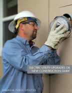 Man installing electric service meter