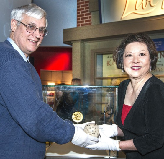 Patti presenting her Grandfather's softball to the Smithsonian