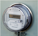Round electrical meter protected in clear plastic covering