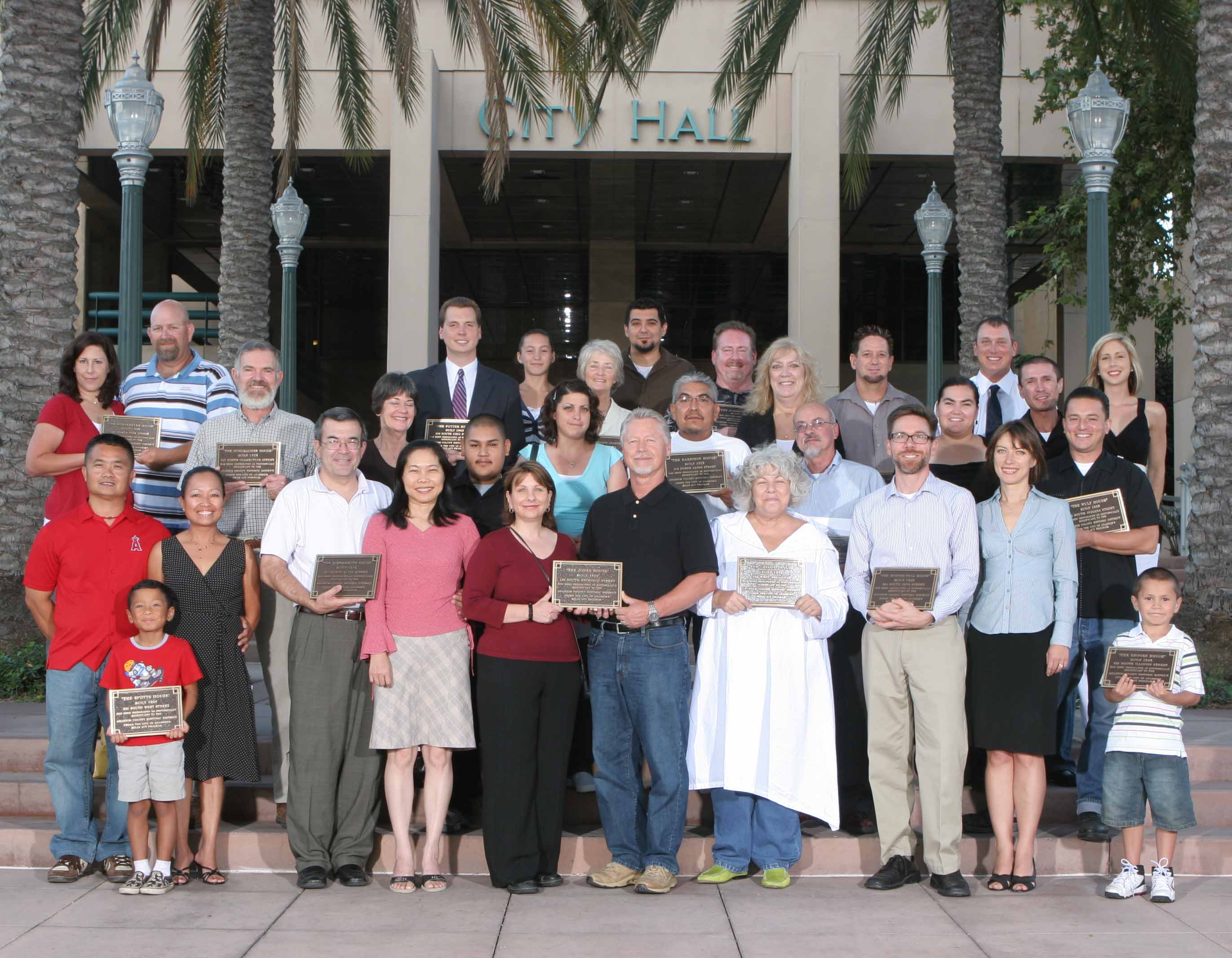 Group photo with the onwers holding their plaques for the Mills Act Participating Properties from 2007