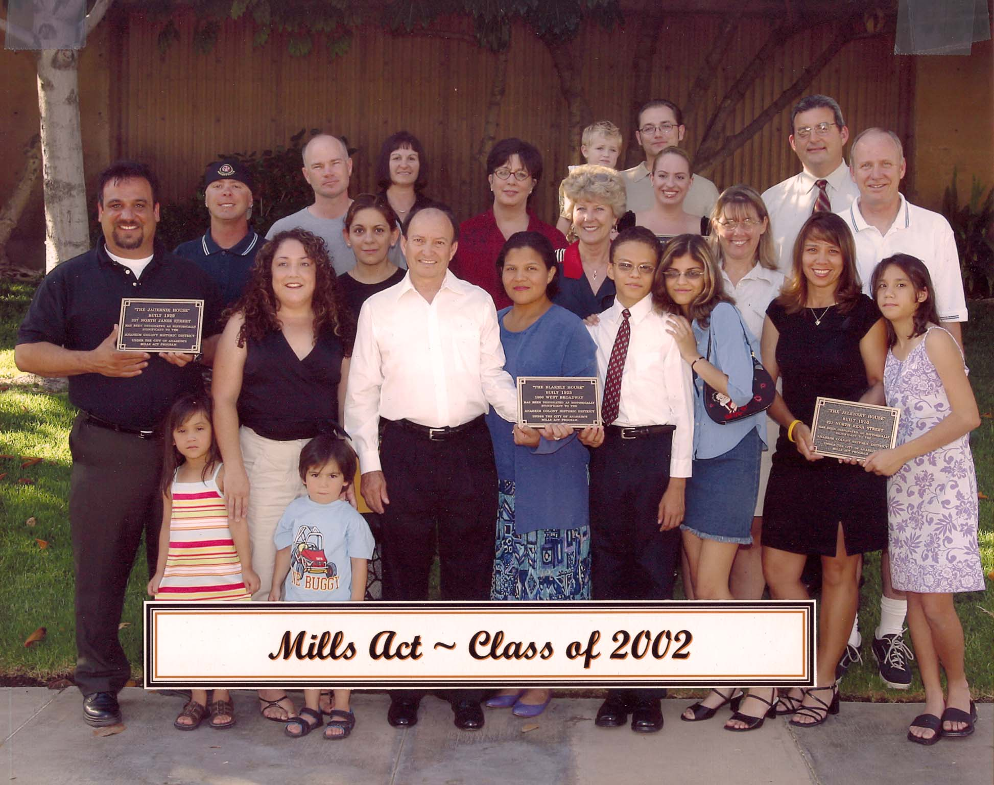 Group photo with the onwers holding their plaques for the Mills Act Participating Properties from 2002