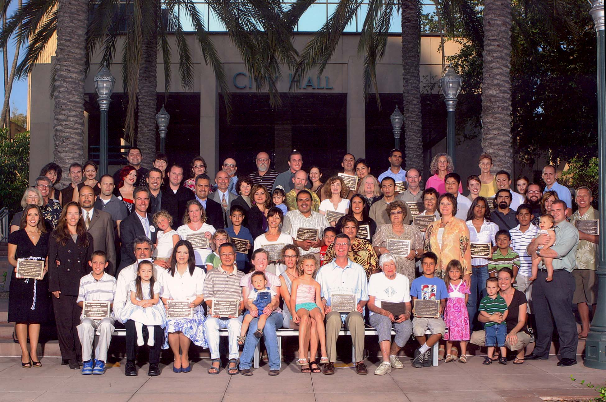Group photo with the onwers holding their plaques for the Mills Act Participating Properties from 2006
