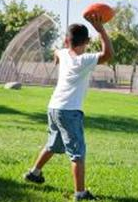 Boy Throwing a Football
