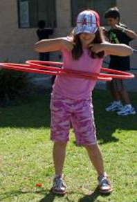 Girl Playing With Hula Hoops