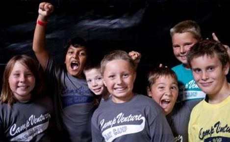 Group of Kids Wearing Camp Venture Shirts Posing f