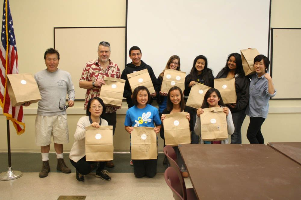 Class photo with their brown paper bags
