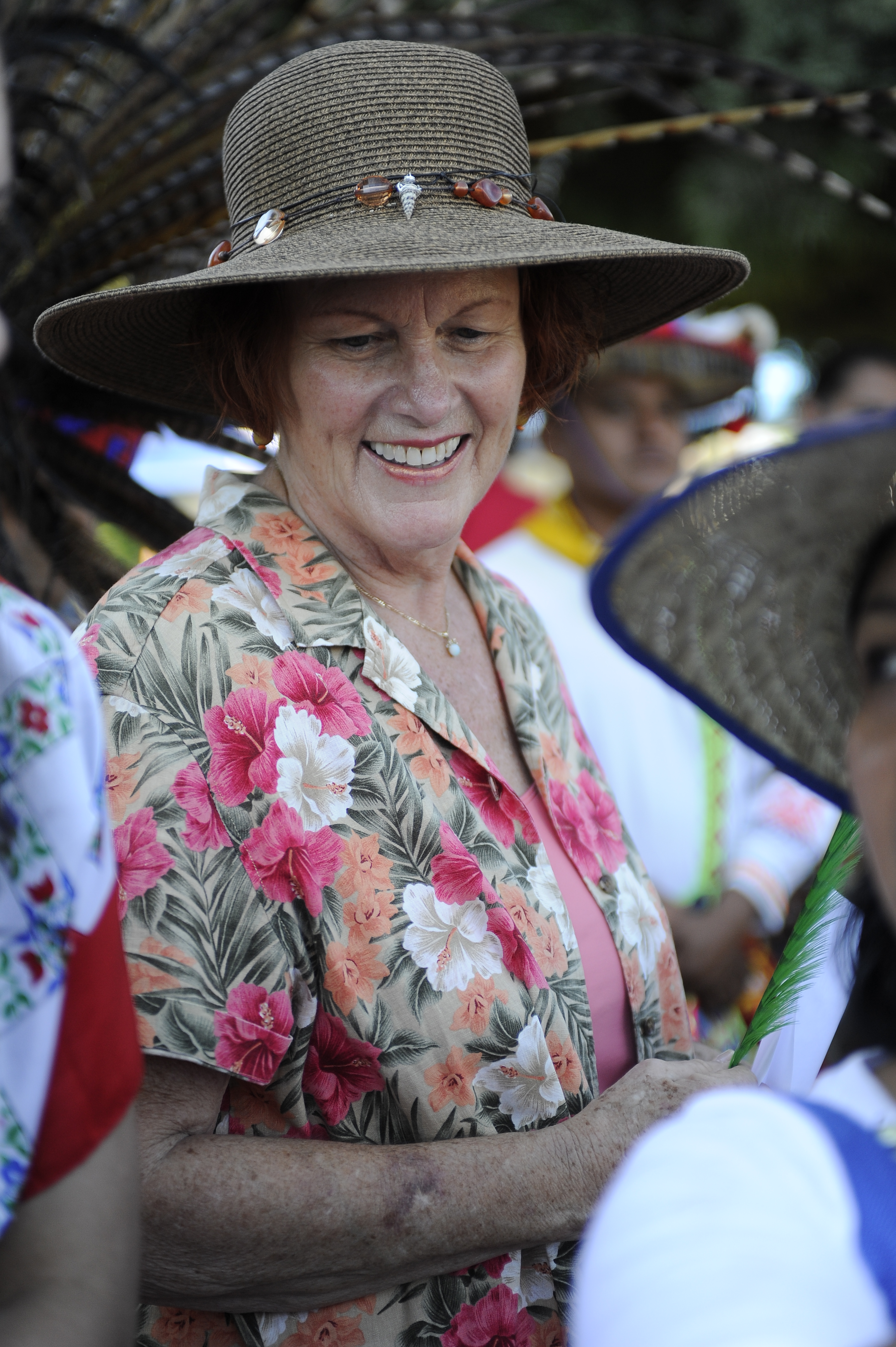 Woman wearing a sun hat and smiling
